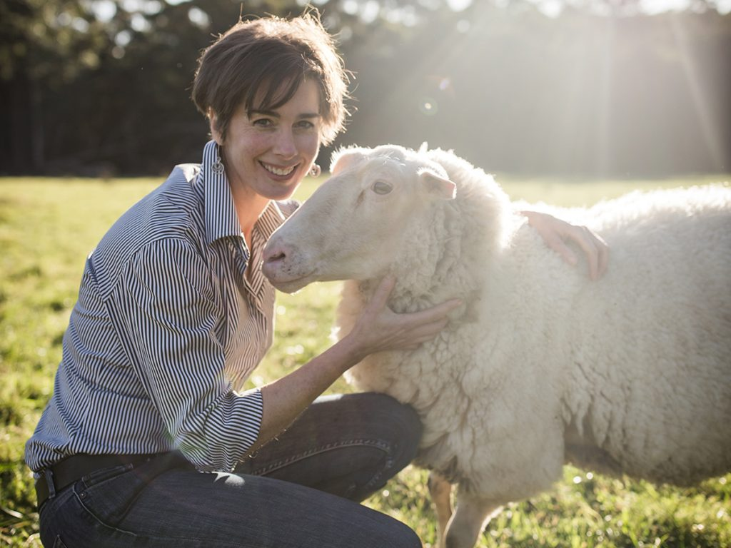 Cressida Cains, winner of 2020 NSW AgriFutures Rural Women's Award with a sheep from her dairy sheep farm, Pecora Dairy