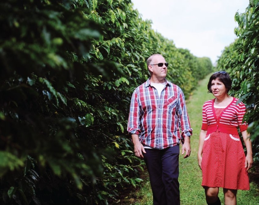 John and Rebecca Zentveld walking through their coffee plantation farm